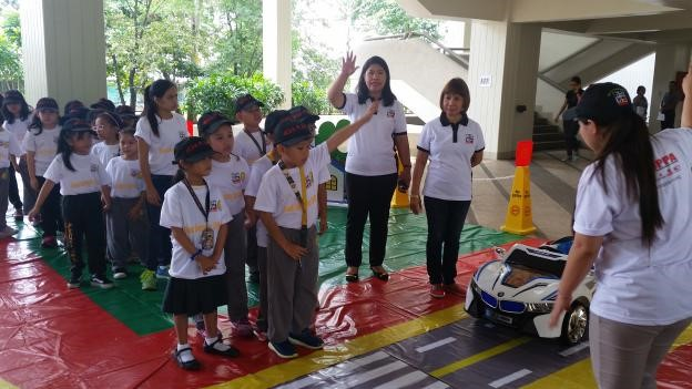 MDPPA members join the grade two pupils in the portable road safety park